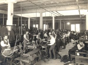 Where Did Pensions Come From - Men at Work in a Sewing Factory - 1907